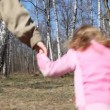 Family of three with little daughter runs from camera to spring forest — Stock Video #26758319