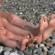 Barefooted baby girl with parents sits on beach — Stock Video