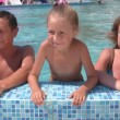 Family in swimmig pool outdoor — Stock Video