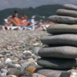 Balanced stones stack on pebble beach — Stock Video