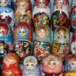 Many souvenir Russian wooden dolls, which are called Matryoshka are on counter in shop — Stock Video #26759193