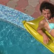Woman in bikini lying near water pool, top view — Stock Video #26759197