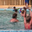Doing aqua aerobic in swimming pool — Stockvideo