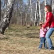 Little girl runs to her young mother and throws into her arms — Stock Video #26759329