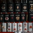 Many souvenir flasks with Soviet and Russisymbols in shop — Stock Video #26759513