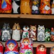 Many souvenir Russian wooden dolls, which are called Matryoshka and figures of temples — Stock Video