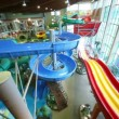 Stock Video: Rapidly slide down wet hills in water park