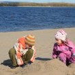 Boy and girl is digging sand and constructing buildings — Stock Video #26759679