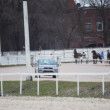 Stock Video: Start of horse competitions on hippodrome with autostart car