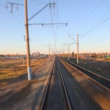 Zooming on the railway from moving train — Stock Video