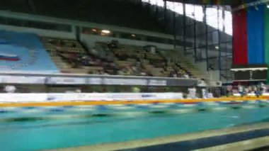 MOSCOW - MAY 10: The open Championship of Russia on swimming on May 10, 2010 in Moscow. move in places before competitions on swimming. Camera moves there-back. Time lapse. — Stock Video