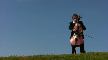 Young man plays violoncello — Stock Video