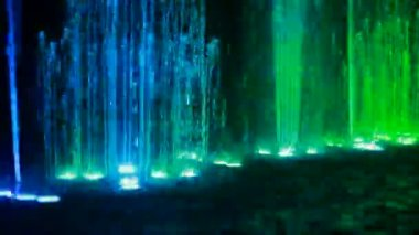 Fountains with different illumination in circus of dancing fountains — Stock Video