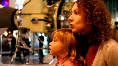 Mother talking with her daughter in the space museum — Стоковое видео