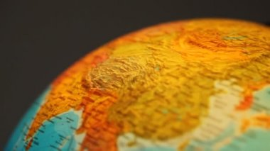 Shone globe rotates indoors close up on gray background — Stock Video