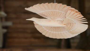 Russian bird of happiness, made of wood hangs by thread under ceiling — Stock Video