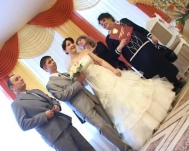 Groom, bride and their parents with registration certificate in registry office — Vidéo