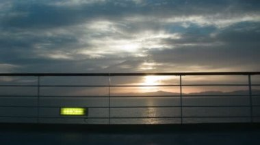 View on a sunset on the sea from a ship deck. Time lapse — Stock Video