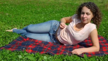 Woman lying on summer field in park — Stock Video