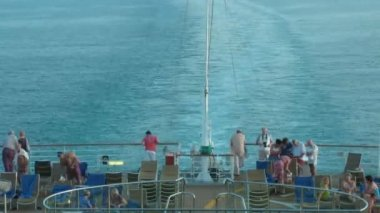 Passengers on a ship deck, on a back part on sunny day. Time lapse — Stock Video