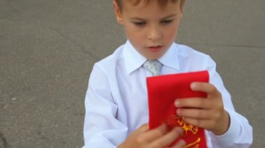 First grader boy rolls up his ribbon — Stock Video