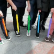 Stock Video: Men placed folded colored umbrellas on foot and stomp