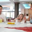 Family has breakfast at the Italian restaurant. — Stock Video