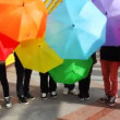 Men spin colorful umbrellas and make them lower down — Stock Video #27512313
