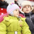 Girl and boy sit on armchairs, attentively watch hockey match — Stock Video #27512471