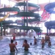 View on an aquapark through a lattice, outdoor in Sochi, Russia. — Stock Video