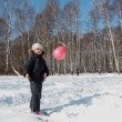 Boy walks and plays with a balloon with propeller — Vídeo Stock
