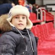 Boy sits in armchair, attentively watch hockey match — Stock Video