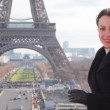Woman stands against Eiffel Tower in Paris, France — Stock Video