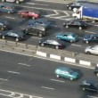 Stock Video: Part of brisk highway in city, sunny day.