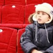 Boy sits in armchair, attentively watch hockey match — Stock Video #27513355