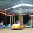 Children go for a drive on machines in fairground attraction. — Stock Video