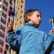 Stock Video: Boy holding toy windmill