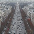 Stock Video: Champs Elysees and big wheel in Paris, view from Triumphal Arch