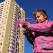 Stock Video: Girl runs toy helicopter