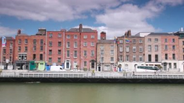 Many and cars moving on street by Liffey River — Stock Video