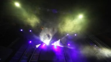 Stage of nightclub with dynamic disco searchlights — Stock Video