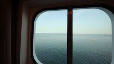 Camera moves to sidelight of passenger cabin in cruise ship — Stock Video