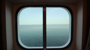 View at sea through sidelight of passenger cabin — Stock video