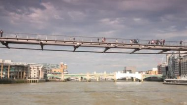 Walking across River Thames on London Millennium Footbridge — Stock Video