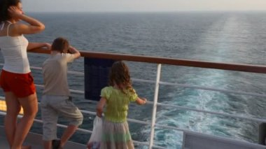 Mother with son and girl stands on deck of ship — Stock Video