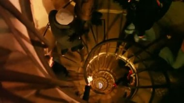 Ascending narrow spiral staircase in old building — Stock Video