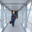 Woman is going away on boarding bridge — Stock Video