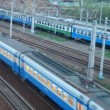 Commuter electric train moving on railroad near station — 图库视频影像 #27544769