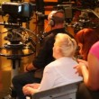 Back view of spectators and cameraman in TV studio during filming — Stock Video
