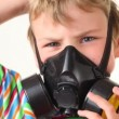 Boy puts on respirator and looks at camera — Stock Video #27545739